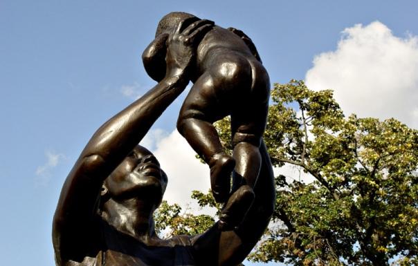 Olmec_Bronze_Woman_Celebration_Sculpture